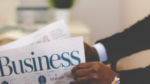 Man reading business section of paper